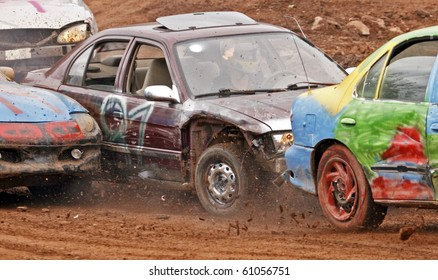NORTON, CANADA - SEPTEMBER 11: Three cars collide at a demolition derby on September 11, 2010 in Norton, Canada.