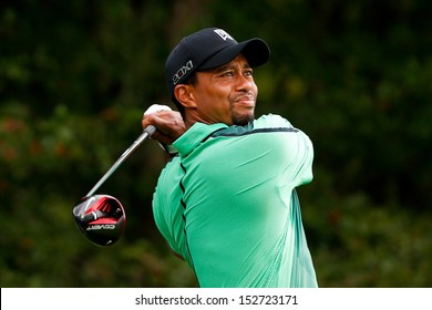 NORTON, MA-SEP 1: Tiger Woods tees off the fourth hole during the third round at the Deutsche Bank Championship at TPC Boston on September 1, 2013 in Norton, Massachusetts.
