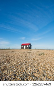 Norton's Hut, blue sky and beach at Rye