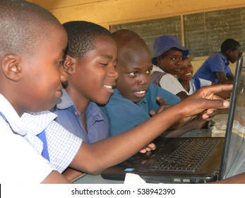 Norton,Zimbabwe,September  17 2015.A  group  of primary  school  children  using  a  computer to  study  as  a  group  in  a  classroom at school.