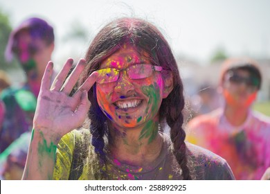 Norwalk, California, USA - March 7, 2015: Unknown women with painted face during the Holi Festival of Colors