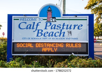 NORWALK, CT, USA - AUGUST 1, 2020: Entrance sign to Calf Pasture Beach in Norwalk about social distancing during COVID-19 virus