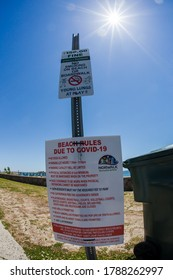NORWALK, CT, USA - JUNE 9, 2020: Informative sign on Calf Pasture Beach  during COVID-19 pandemic