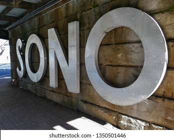 NORWALK, CT, USA - MARCH 26, 2019: SONO ( South Norwalk) sign on Washington St. under railroad bridge.