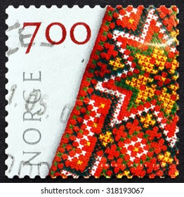 NORWAY - CIRCA 2001: a stamp printed in the Norway shows Embroidered Bunad, Crafts, circa 2001
