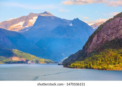 Norway colorful sunset Nordfjord fjord panorama with mountains landscape and cruise ship