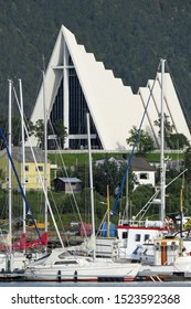 Tromsø, Norway, Europe - August 04, 2013: View on sailing boats in the harbor in front of the Arctic Cathedral or Tromsdalen Church