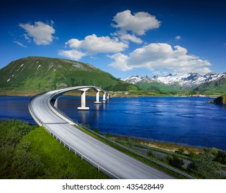 Norway famous bridge with mountains in background. Beautiful road over river in nature.