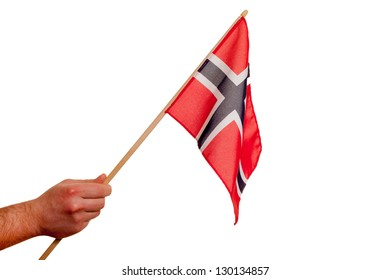 Norway flag in hand on white background.