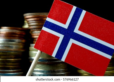 Norway flag waving with stack of money coins macro