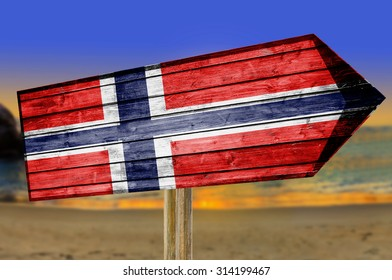 Norway Flag wooden sign on beach background