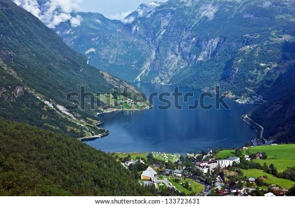 Norway, Geiranger fjord. Mountains and Norwegian village