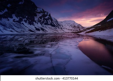 Norway Glacier lake after sunset - drone photo, ice in foreground