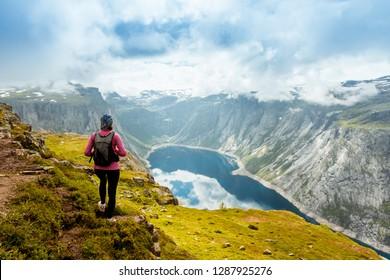 Norway hike. Sporty woman on top of rock near Trolltunga