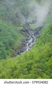 Norway hiking area, scenic mountains landscape in summer by misty foggy rainy weather