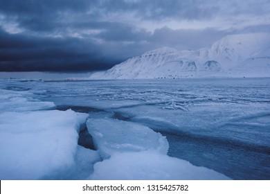 norway landscape ice nature of the glacier mountains of Spitsbergen Longyearbyen  Svalbard   arctic ocean winter  polar day blue sky