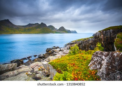 Norway landscape. Senja island nature. Seascape with blue sea water and cloudy dramatic sky.