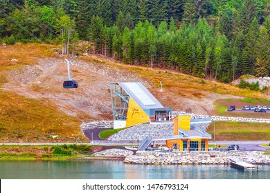 Norway, Loen - August 1, 2018: Skylift aerial tramway cabin and station near Olden. The cable car climbs to the top of Mount Hoven, above the Nordfjord fjord