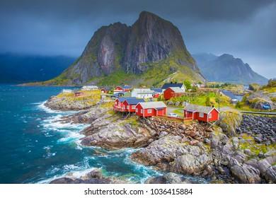 Norway, Lofoten islands. Spring day in Norway. Beautiful seascape of Lofoten islands. Red fishing houses on stone seaside.