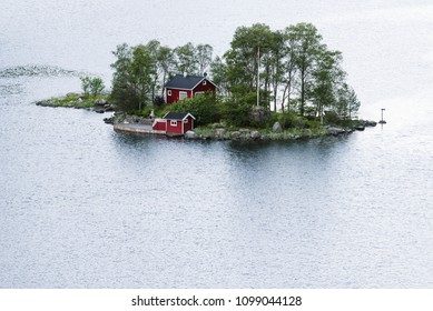 Norway, Lovrafjorden, July 05, 2017: lonely house with a manor on a small island in the fjord