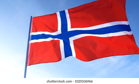 Norway national flag in the blue sky.