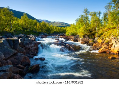 Norway nature. Mountain river with stone riversides at the sunset. Beautiful wild landscape with stream in mountains.
