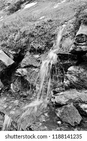 Norway nature - small stream waterfall in Strynefjellet mountain area. Vintage black and white style.