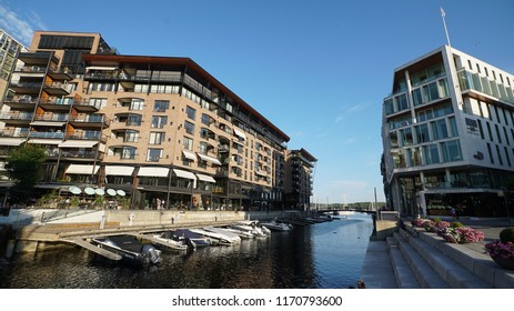 Norway, Oslo, 23 July 2018: Modern buildings known as Barcode Project under construction in the center of Oslo at the sunset