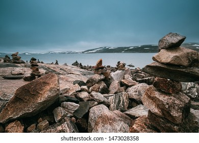 Norway. Stones On Coast Of Beautiful Lake Orteren In Spring Cloudy Day. Norwegian Nature.