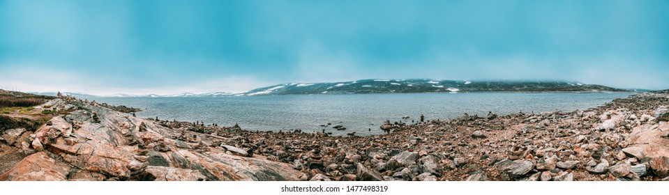 Norway. Stones On Coast Of Beautiful Lake Orteren In Spring Cloudy Day. Norwegian Nature. Panorama, Panoramic View