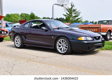 Norway, Wisconsin / USA - June 30, 2019:  A sleek mid 1990s Ford Mustang Cobra on display at the Wind Lake Car Show.