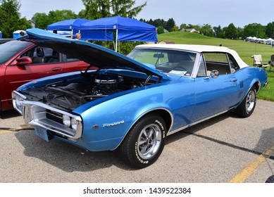 Norway, Wisconsin / USA - June 30, 2019:  A beautiful blue 1967 Pontiac Firebird Convertible with white top and interior at display at the Wind Lake car show.