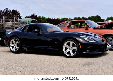 Norway, Wisconsin / USA - June 30, 2019: A beautiful Black Dodge Viper with shining aluminum wheels being displayed at the  Wind Lake Car Show.