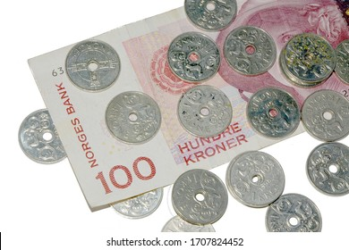 A Norwegian Bank (Norges Bank) 100 Kroner note surrounded by 1 Kroner coins