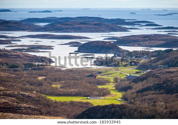 Norwegian coastal landscape with sea, islands and spring field