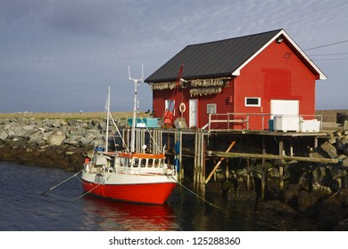 Norwegian fishing boat with fishing house on island of Vaeroy, Lofoten