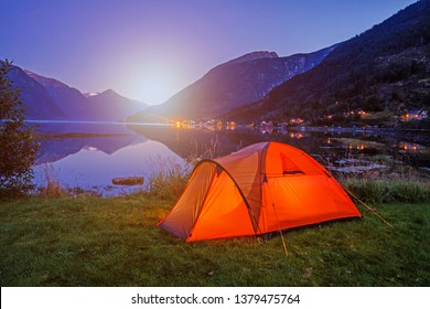 Norwegian fjord landscape with camping tent. Norway adventure. Outdoor