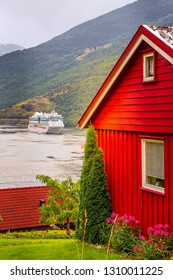 Norwegian fjord landscape, red wooden house and cruise ship in Norway, Flam