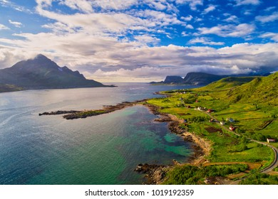 Norwegian fjord, with a narrow road by the shore