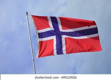 Norwegian Flag against a blue sky