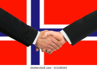 The Norwegian flag and business handshake