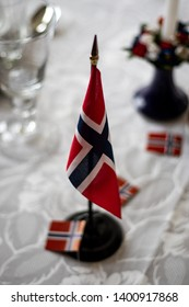 Norwegian flag on table, decorated for 17th of May, Norways national day, celebrations.