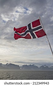 Norwegian flag and view to the Lofoten islands