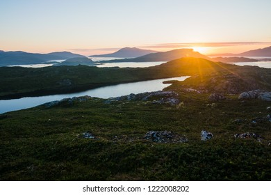 Norwegian landscape with the beautiful midnight sun north of the polar circle