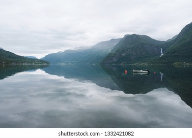 Norwegian landscape with fjord and mountain range. Lusterfjord fjord. Commune Luster, Norway. Overcast weather