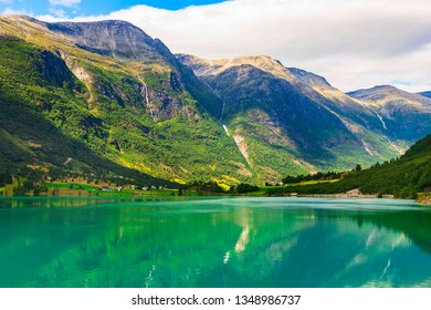 Norwegian landscape with Nordfjord fjord, mountains, and waterfalls in Olden, Norway