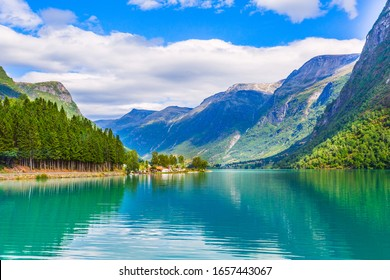Norwegian landscape with Nordfjord fjord, mountains, forest and glacier in Olden, Norway