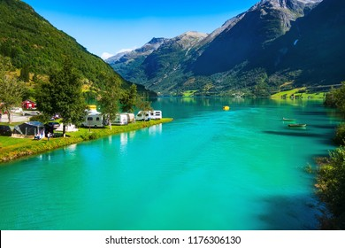 Norwegian landscape with turquoise fjord water, mountains and camping. Olden, Norway