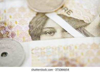 Norwegian money detail - hungry eyes of norwegian economy. Shallow depth of field. Eye detail.