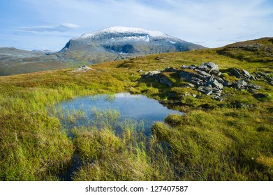 Norwegian mountain landscape at fall. Mt. Tromsdalstinden